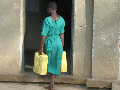 Ugandan girl carrying water