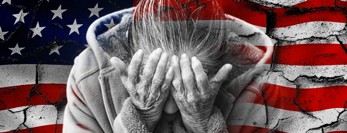 Woman with head in her hands with American flag in background