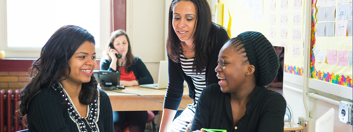 Female teacher in classroom with two students