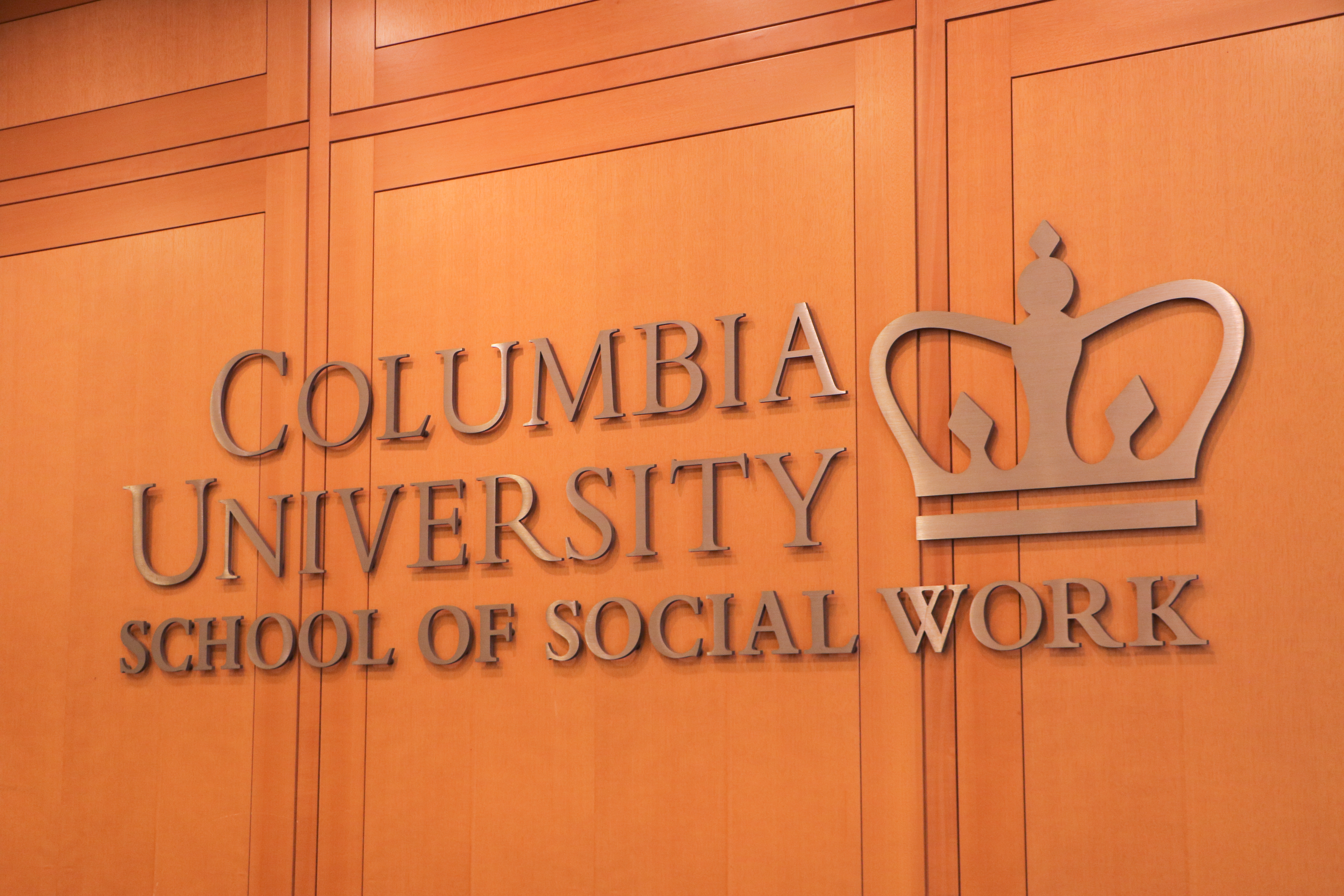 Columbia University School of Social Work Logo on Wooden Wall